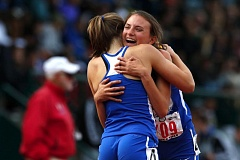 TRIBUNE PHOTO: JONATHAN HOUSE - Grant senior Rennie Kendrick (right) hugs teammate Ella Donaghu after the Generals' 4x400 relay, which included Cassin Wright and Zoe Shaw, won the final event of the Class 6A girls track and field championships Saturday in Eugene.