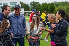 COURTESY: CHALLENGED ATHLETES FOUNDATION - Alexzya Boyd (center), a 15-year-old double amputee who attends Evergreen High in Vancouver, Washington, is surprised Saturday when presented with two new Flex-Run feet with Nike Soles during a clinic at Nike.