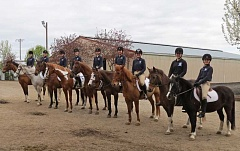 SUBMITTED PHOTO - Local equestrians pose to capture the moment. From left are members of Lakeridge and Lake Oswego high school equestrian teams: Paige Vizza, Anika Kraus, Renee Kozlowski, Claire Torkelson, Caeli Griffin, McKenna Anders, Katie Healy, Monica Holliday and Megan Erickson.