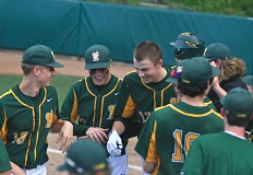MATTHEW SHERMAN - Will Matthiessen, center, is greeted at home plate after hitting a three-run home run that gave West Linn a lead it wouldn't surrender in a 4-3 victory over South Medford on Monday.
