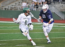 MATTHEW SHERMAN - West Linn's K.T. Seth gets past a Lake Oswego defender during Tuesday's playoff game. The Lions advanced to the quarterfinals with a 6-4 victory over the No. 10 Lakers.