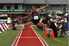 DAN BROOD - Tualatin High School senior Karina Moreland takes off during triple jump competition Saturday at the Class 6A state track and field championships. Moreland won the event with a distance of 38-4.