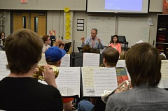 SPOTLIGHT PHOTO: NICOLE THILL - Scappoose High School band director Larry Jackson leads the symphonic band during a rehearsal in December. The symphonic band is one of four musical ensembles that will travel to Vancouver, British Columbia, at the end of May.