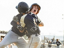 NEWS-TIMES PHOTOS: CHASE ALLGOOD - Hayden Vandehey hugs Gunnar Partain and yells as he celebrates crossing home for the winning run Wednesday.