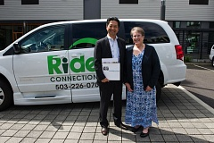 COURTESY TOYOTA - Osamu Nagata, Executive Vice President of Toyota Motor North America, with Elaine Wells, Executive Director of Ride Connection. Toyota is supporting the regional transportation service for seniors and peoplke with disabilities.