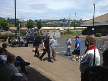 KOIN 6 NEWS PHOTO/BRIAN KIPE - Police officers in Tigard arrest a man who allegedly drove his pickup truck through a cornhole tournament outside JB O'Briens Pub.