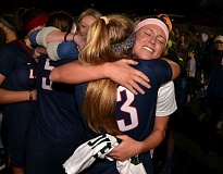 VERN UYETAKE - West Linn's Natalie Byrne gives a hug to Lake Oswego's Rowan Anderson following last week's state championship game at Wilsonville High School. The Lions fell 12-8 in the contest.