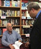 PAMPLIN MEDIA GROUP: PETER WONG - While signing his new book at Powell's Hawthorne store, journalist Floyd McKay visited with state Rep. Lew Frederick who, like McKay, worked for KGW.