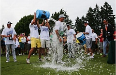 COURTESY: ERIC EVANS - Oregon Ducks golfers give coach Casey Martin a celebratory shower moments after the U of O men claimed the national championship at Eugene Country Club.