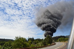 COURTESY COLUMBIA RIVERKEEPER - A large black plume of smoke was observed in Mosier, in the Columbia River Gorge, Friday afternoon, after a train reportedly carrying crude oil derailed.