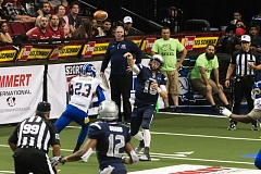 TRIBUNE PHOTO: CHRISTOPHER OERTELL - Quarterback Shane Austin of the Portland Steel unloads a long touchdown pass to James Perry, just before taking a hit from the Tampa Bay Storm's Nick Addison, as Portland receiver Tyrone Goard runs a shorter route Friday night at Moda Center.