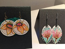 SUBMITTED PHOTO - Bonnie Merchant works on designs for her paper earrings. Visitors to the Open Studios of Beavercreek will see her at work all three days.