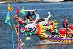 PAMPLIN MEDIA GROUP FILE PHOTO - The Rose Festival brings out many citizens for the Dragon Boat Races. Says Tom Crowder, longtime organizer: 'We're slowly building it back up.' Sixty-five teams are expected to compete this weekend.