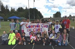 SUBMITTED BY MARLENE MACEWAN - Hopkins Elementary fifth-grade teacher Marika Conrad (far right) poses with her class on the track where the Relay Recess walk took place June 10; her students took on leadership roles to promote the event.