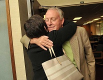 REVIEW PHOTO: VERN UYETAKE - Clackamas Education Service District Superintendent Milt Dennison receives a big hug from Vickie Chamberlain.