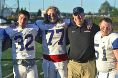 MATTHTEW SHERMAN - Linemen, Garrett Keizur, Tom Laverde and Hayden Bell stand with coach Eric Mahlum following Saturday's game in Hillsboro.