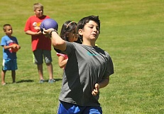 TIDINGS PHOTO: VERN UYETAKE - Ethan Gitler, 11, makes a throw during a friendly game of dodgeball at Willamette Park Thursday, June 30.