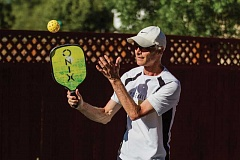 NEWS-TIMES PHOTO: CHASE ALLGOOD - Steve Paranto warms up prior to a game of pickleball with friends at his Hillsboro home last Wednesday evening.