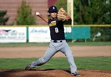 DAN BROOD - Sherwood High School junior-to-be Takumi Kammerzell gets ready to fire in a pitch during the Bowmens's OIBA game with Wilsonville on Tuesday. Kammerzell threw a one-hit shutout in Sherwood's 2-0 win.