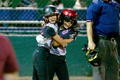 JAIME VALDEZ - Tualatin City's Talia Valdez (left) and Ariel Chanez hug following Chanez' two-run home run in the team's 10-8 win over Tigard on Monday.