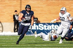 PHOTO COURTESY OF UTAH STATE UNIVERSITY - Horizon Christian High School graduate Wyatt Houston (left) heads up field after catching a pass in last year's game against BYU.