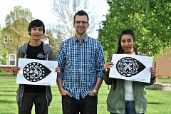 COURTESY PHOTO: RACHEL REITZ - South Meadows Middle School art teacher Brian Cook, center, encouraged students Erich Flint, left, and Joselene Roman, right, to help design Shute Seeds.