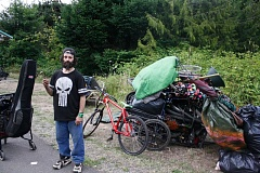 OUTLOOK PHOTO - Unhoused man Rey Drennen, 43, stands next to his belongings after workers began clearing a homeless camp on the Springwater Corridor on Tuesday, July 19.
