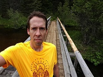 CONTRIBUTED PHOTO - Outlook writer Scott Pesznecker stops for a quick snapshot on a bridge while doing the 13-mile loop around Timothy Lake.