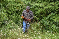 COURTESY PHOTOS - Dave Peecher of Hillsboro limbs-up his trails during a regular July maintenance trip to his favorite hunting grounds.