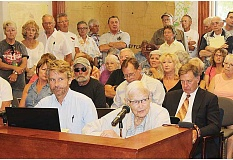HOLLY M. GILL - Herb Anderson, 95, at microphone, purchased property at Three Rivers in the 1950s, and has offered an easement to the DeMonte Trust for its proposed 10-lot subdivision. Seated with Anderson is his son, Tom.