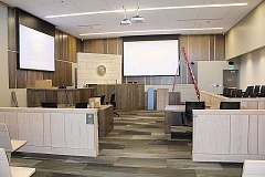 HOLLY M. GILL - The new courtrooms feature two projectors with large screens, stained oak veneer woodwork, and carpet tile flooring. The two larger courtrooms have adjacent cells for in-custody defendants.