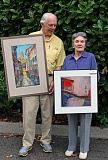 REVIEW PHOTO: JILLIAN DALEY - Steve Ludeman and Evelyn Fritz stopped recently at The Review's office in downtown Lake Oswego to hang a new batch of paintings from Lake Area Artists members.