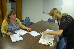 PHOTO BY RAYMOND RENDLEMAN - Co-chief petitioner Veronica Reichle turns in the signatures for the park measures to Assistant City Administrator Jackie Betz at Gladstone City Hall.
