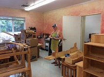 COURTESY PHOTOS - Swallowtail kindergarten teacher Ms. Josclyn paints her new room in preparation for the school year.