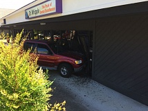 PHOTO COURTESY OF THE TIGARD POLICE DEPARTMENT - A truck reportedly driven by a 92-year-old King City man crashed through the front of a business office along Southwest Durham Road in Tigard on Wednesday, police reported.
