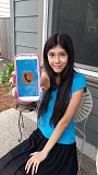 COURTESY PHOTO - Madeline Haynes of Forest Grove, 14, has created an Android app that connects users with a suicide hotline at the touch of a button.