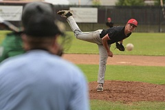 SANDY POST: DAVID BALL - Cody Anderson fires a pitch during Advanced Metals 11-7 win over Rex Putnam on Saturday.