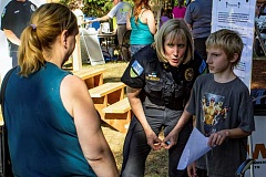 NEWS-TIMES FILE PHOTO - Forest Grove Police Chief Janie Schutz meets a few of National Night Out's younger attendees.