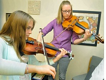 GARY ALLEN - Thirteen-year-old Marigrace Williams of Newberg studies the violin with Rebekah Hanson Monday evening at George Fox University.