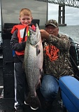 Eight-year old Blaydn Lampien of Oregon City with his first salmon, caught on a size 6 chartreuse/green dot Fatal Flash spinner at Buoy 10 last week.