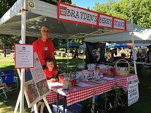 SUBMITTED PHOTO - Brayden Arsenault gears up for a day of selling berries with his grandpa at Canby's First Friday Street Faire.