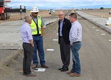 HOLLY M. GILL - From left, Kaz Kawamoto, Daimler construction manager, Jesse Oatman, project superintendent for Kirby Nagelhout Construction Co., U.S. Rep. Greg Walden, and Todd McIntyre, project manager for Kirby Nagelhout, tour the test track site, where precast forms are being installed.