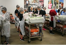 JIM BESEDA/CLACKAMAS REVIEW - Members of the Rex Putnam volleyball team joined other volunteers at the Oregon Food Bank in Beaverton Saturday, bagging, weighing and boxing hundreds of 2-pound bags of frozen green peas.