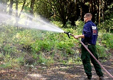 BILL TAYLOR - Jason McGillivray, of the Oregon Dept. of Forestry, watering a restoration planting site in the Molalla River Corridor with fire hose.