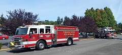 BARBARA SHERMAN - Two Tualatin Valley Fire & Rescue engines from Stations 35 and 51 participated in the King City/King City Civic Association 50th anniversary parade on Aug. 13