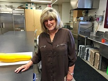 SUBMITTED PHOTO - Carole Lukas, who is not related to George Lukas, helps serve and clean up lunches on Mondays at the West Linn Adult Community Center. More volunteers are needed for a variety of jobs.