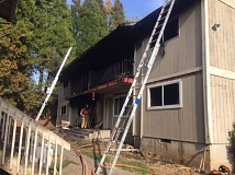 PHOTO COURTESY: CLACKAMAS FIRE - Crews remained on scene hours after the Jenning Lodge fire was under control to extinguish hot spots.
