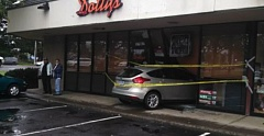 COURTEST PHOTO - A car sits half in, half out of the Dottys Deli this morning at the Sandy Marketplace on Highway 26 in Sandy. This photo first appeared on the Sandy Neighborhood Watch Facebook page
