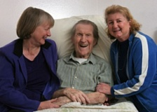 FILE PHOTO - Laurie Monnes Anderson, left, and her sister Janet Ibrisimobic share a rare light moment with their father, Bud Monnes, at his Gresham care facility on Thursday, June 12, 2008.