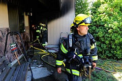 COURTESY PHOTO - Hillsboro firefighters brought a residential fire at 650 S.E. 20th Place in Hillsboro under control Sunday afternoon, Sept. 11, and arrested its occupant, 30-year-old Sara N. Brown.